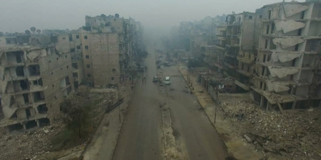 A still image from video taken December 13, 2016 of a general view of bomb damaged eastern Aleppo, Syria in the rain. Video released December 13, 2016.      REUTERS/via ReutersTV