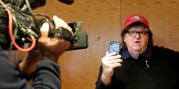 NEW YORK, NY - NOVEMBER 12: Filmmaker Michael Moore films himself with a smartphone at Trump Tower on November 12, 2016 in New York City. President-elect Donald Trump is holding meetings at his Trump Tower residence amid increased security in the area.  (Photo by Yana Paskova/Getty Images)