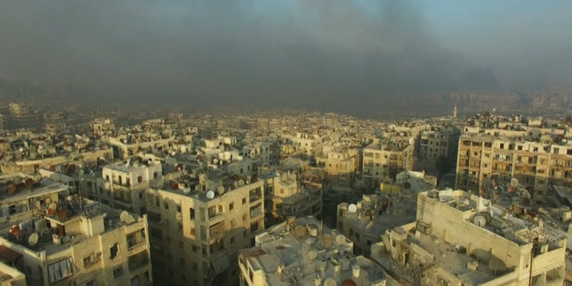 A still image from video taken December 12, 2016 of a general view of smoke rising over bomb damaged eastern Aleppo, Syria. Video released December 12, 2016.      REUTERS/via ReutersTV
