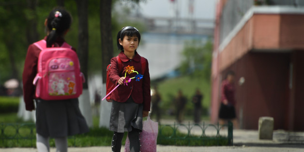 PYONGYANG, NORTH KOREA - MAY 9:  Young girls walk by themselves without adults in Pyongyang, North Korea on May 9, 2016.   It's not uncommon to see young kids walking in public alone in North Korea.  Some Koreans say they have no worries that the streets or the people on them are unsafe.  (Photo by Linda Davidson / The Washington Post via Getty Images)