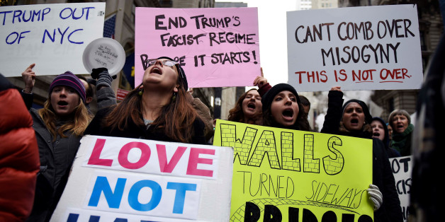 Protesters against U.S. President-elect Donald Trump shout slogans while demonstrating near Trump Tower in the Manhattan borough of New York, U.S. November 20, 2016. REUTERS/Mark Kauzlarich