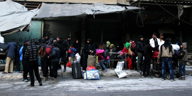 ALEPPO, SYRIA - DECEMBER 15: Civilians from the besieged area wait to be evacuated from eastern Aleppo under the siege of Iranian-led Shia militias and Assad regime forces in Aleppo, Syria on December 15, 2016. (Photo by Ahmad Hashesho/Anadolu Agency/Getty Images)