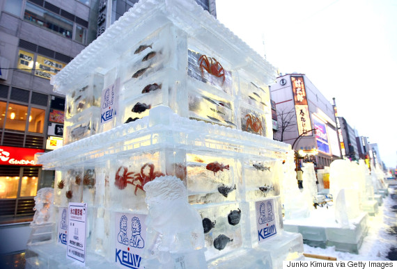 ice sculpture with real fish frozen inside during