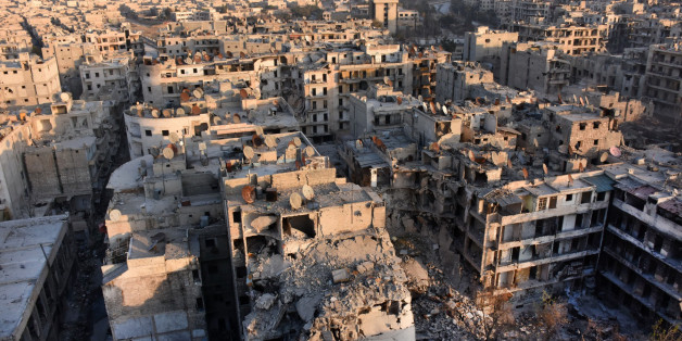 A general view of Aleppo taken from the top of a building in the city's Bustan al-Basha neighbourhood on November 28, 2016, during Syrian government forces assault to retake the entire northern city from rebel fighters.In a major breakthrough in the push to retake the whole city, regime forces captured six rebel-held districts of eastern Aleppo over the weekend, including Masaken Hanano, the biggest of those in eastern Aleppo.   / AFP / GEORGE OURFALIAN        (Photo credit should read GEORGE OU
