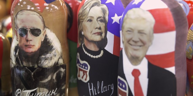 Traditional Russian wooden dolls called Matreska depicting from left, Russian president Vladimir Putin and US presidential candidates Hillary Clinton and Donald Trump are displayed in a shop in Moscow, Russia on Tuesday, Nov. 8, 2016. Tens of millions of voters across the United States will now decide on the next occupant of the White House as polling stations open across the country. (AP Photo/Pavel Golovkin)