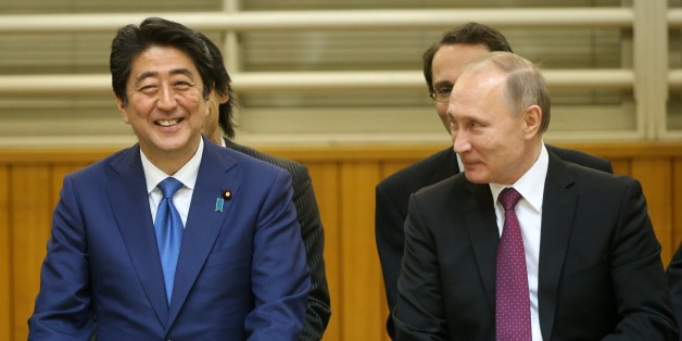 TOKYO, JAPAN - DECEMBER 15: (RUSSIA OUT) Russian President Vladimir Putin (R) and Japanese Prime Minister Shinzo Abe (L) are seen visiting the Kodokan Judo Institute on December 16, 2016  in Tokyo, Japan. Russian President is on a two-day visit to Japan. (Photo by Mikhail Svetlov/Getty Images)
