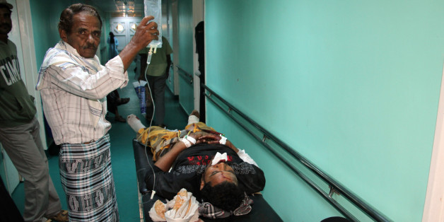 A wounded Yemeni receives treatment at a hospital in Aden on December 18, 2016, after a suicide bomber targeted a crowd of soldiers at al-Sawlaba base. A suicide bomber killed at least 30 Yemeni soldiers when he detonated his targeting a crowd of soldiers gathered to collect their salaries at a base in northeastern Aden, military officials and medics said. / AFP / SALEH AL-OBEIDI        (Photo credit should read SALEH AL-OBEIDI/AFP/Getty Images)