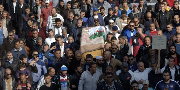 Relatives and friends carry the body of British-Algerian journalist Mohamed Tamalt as mourners walk towards the cemetery during his funeral, on December 12, 2016 in Algiers.Mohamed Tamalt died on December 11, 2016 after having staged a hunger strike to protest a two-year jail term for offending Algeria's president in a poem posted online, his lawyer said. / AFP / RYAD KRAMDI        (Photo credit should read RYAD KRAMDI/AFP/Getty Images)