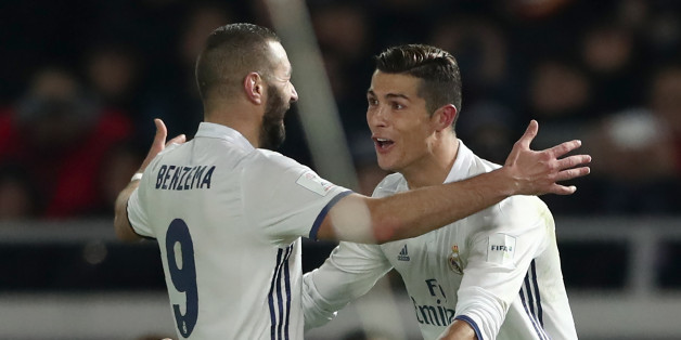 Real Madrid forward Cristiano Ronaldo (R) celebrates scoring during extra-time with teammate Karim Benzema during the Club World Cup football final match between Kashima Antlers of Japan and Real Madrid of Spain at Yokohama International stadium in Yokohama on December 18, 2016. / AFP / Behrouz MEHRI        (Photo credit should read BEHROUZ MEHRI/AFP/Getty Images)
