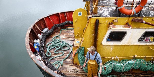 A fisherman prepares for the departure of the Trevessa IV fishing trawler vessel in Newlyn harbour in Newlyn, U.K., on Friday, Aug. 12, 2016. As an island with a long coastline positioned close to the productive fishing grounds of the European continental shelf the U.K. has a long history of fishing, according to a report published on the United Nations' Food & Agriculture Organization website. Photographer: Simon Dawson/Bloomberg via Getty Images