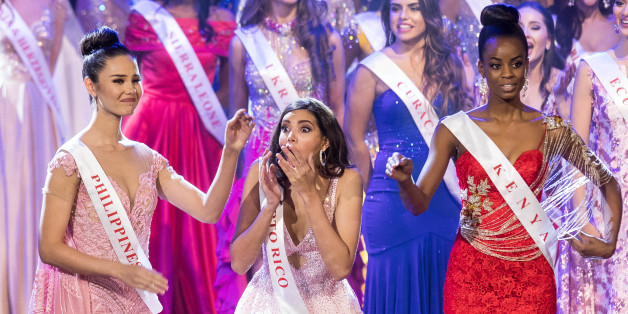 Miss Puerto Rico Stephanie Del Valle (C) reacts after winning in the Grand Final of the Miss World 2016 pageant at the MGM National Harbor December 18, 2016 in Oxon Hill, Maryland.   / AFP / ZACH GIBSON        (Photo credit should read ZACH GIBSON/AFP/Getty Images)