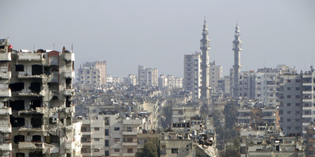 A general view shows damaged buildings in the northwestern Homs district of Al Waer January 18, 2015.  REUTERS/Stringer (SYRIA - Tags: CITYSCAPE CIVIL UNREST CONFLICT)
