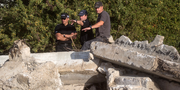 KOS, GREECE - OCTOBER 08:  South Yorkshire Police officers look over the new second search site approximately 1km from the farmhouse search site of missing toddler Ben Needham on October 8, 2016 in Kos, Greece. The 21 month old toddler from Sheffield vanished on the Greek island in July of 1991. A 19-strong team of police officers, forensic specialists and an archaeologist have been searching an olive grove next to the farm for the past twelve days and have now begun work on a second site, where