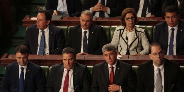 (Front row from L-R) Tunisia's Interior Minister Hedi Majdoud, Defence Minister Farhat Horchani, Justice Minister, Ghazi Jribi and premier-designate Youssef Chahed, (back row from L-R) Foreign Minister Hematines Jhinaoui, Minister of Religious Affairs Abdeljalil Ben Salem, Minister of Finance Lamia Zribi and Minister to the Head of State for Parliament Relations Iyad Dahmani attend a parliamentary session to present his Chahed's governement at the parliament in Tunis on August 26, 2016. It is li