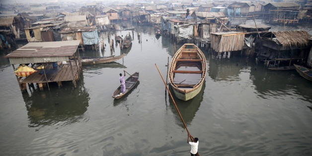 A view of the Makoko fishing community is seen from top of a floating school on the Lagos Lagoon, Nigeria February 29, 2016. In Makoko, a sprawling slum of Nigeria's megacity Lagos, a floating school capable of holding up to a hundred pupils has since November brought free education to the waterways known as the Venice of Lagos. It offers the chance of social mobility for youngsters who, like most of the city's 21 million inhabitants, lack a reliable electricity and water supply and whose water-