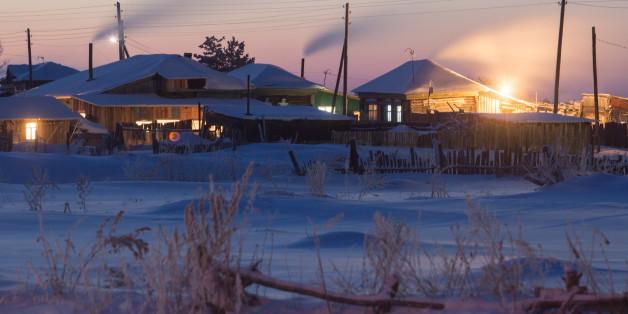 OMSK REGION, RUSSIA - DECEMBER 18, 2016: Snow covered residential houses in the village of Bolsherechye. Dmitry Feoktistov/TASS (Photo by Dmitry Feoktistov\TASS via Getty Images)