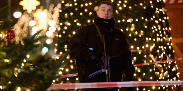 BERLIN, GERMANY - DECEMBER 19:  A policeman with a submachine gun stands at the area after a lorry truck ploughed through a Christmas market on December 19, 2016 in Berlin, Germany. Several people have died while dozens have been injured as police investigate the attack at a market outside the Kaiser Wilhelm Memorial Church on the Kurfuerstendamm and whether it is linked to a terrorist plot.  (Photo by Sean Gallup/Getty Images)