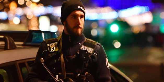 A policeman stands near the site where a truck speeded into a christmas market in Berlin, on December 19, 2016 killing nine persons and injuring at least 50 people. / AFP / John MACDOUGALL        (Photo credit should read JOHN MACDOUGALL/AFP/Getty Images)