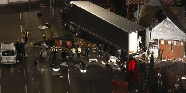 Authorites continue to remove bodies hours after a truck sped into a Christmas market in Berlin, on December 19, 2016, killing at least nine people and injuring dozens more.Ambulances and heavily armed officers rushed to the area after the driver drove up the pavement of the market in a square popular with tourists, in scenes reminiscent of the deadly truck attack in the French city of Nice last July. / AFP / Odd ANDERSEN        (Photo credit should read ODD ANDERSEN/AFP/Getty Images)