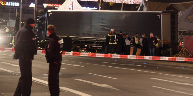 BERLIN, GERMANY - DECEMBER 19:  Police and investigators stand at a black truck that ploughed through a Christmas market on December 19, 2016 in Berlin, Germany. At least nine people have died as police investigate the attack and whether it is linked to a terrorist plot.  (Photo by Sean Gallup/Getty Images)