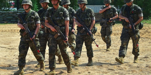 South Korean marines move after a demonstration during a press tour to General Outpost (GOP) of 2nd Marine Division at a military base in Gimpo near the Demilitarized Zone dividing the two Koreas on June 10, 2016.The Korean peninsula is the world's last Cold War frontier as Stalinst North Korea and pro-Western South Korea have been technically at war since the 1950-53 Korean War. / AFP / JUNG YEON-JE        (Photo credit should read JUNG YEON-JE/AFP/Getty Images)