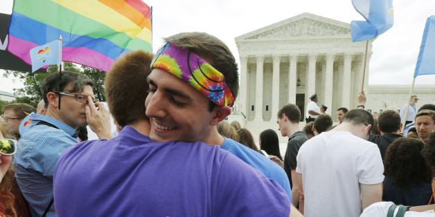 Gay rights supporters celebrate after the U.S. Supreme Court ruled that the U.S. Constitution provides same-sex couples the right to marry, outside the Supreme Court building in Washington, June 26, 2015. The court ruled 5-4 that the Constitution's guarantees of due process and equal protection under the law mean that states cannot ban same-sex marriages. REUTERS/Jim Bourg