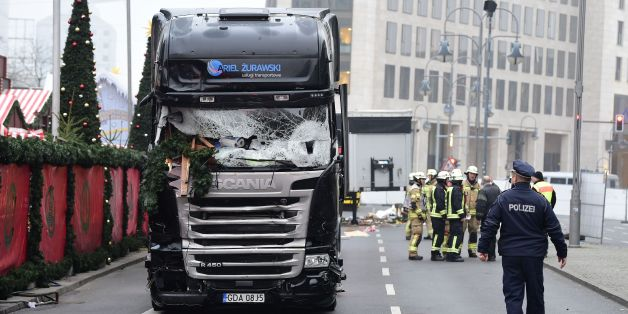 A policeman walks past a truck that crashed into a Christmas market on December 20, 2016 in Berlin.German police said they were treating as 'a probable terrorist attack' the killing of 12 people when the speeding lorry cut a bloody swath through the packed Berlin Christmas market. / AFP / Tobias SCHWARZ        (Photo credit should read TOBIAS SCHWARZ/AFP/Getty Images)
