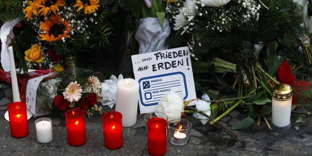 BERLIN, GERMANY - DECEMBER 20: A message reading freedom on Earth lays between flowers at the area after a lorry truck ploughed through a Christmas market  on December 20, 2016 in Berlin, Germany. So far 12 people are confirmed dead and 45 injured. Authorities have confirmed they believe the incident was an attack and have arrested a Pakistani man who they believe was the driver of the truck and who had fled immediately after the attack. Among the dead are a Polish man who was found on the passe