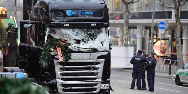 Policemen stand next to a truck on December 20, 2016 at the scene where it crashed into a Christmas market near the Kaiser-Wilhelm-Gedaechtniskirche (Kaiser Wilhelm Memorial Church) in Berlin.German police said they were treating as 'a probable terrorist attack' the killing of 12 people when the speeding lorry cut a bloody swath through the packed Berlin Christmas market. / AFP / Tobias SCHWARZ        (Photo credit should read TOBIAS SCHWARZ/AFP/Getty Images)