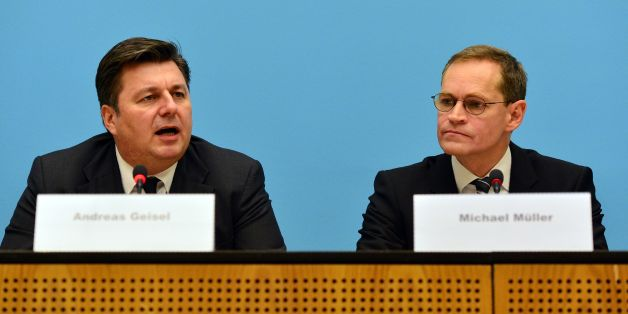Berlin's mayor Michael Müller (R) and Interior Senator Andreas Geisel (L) give a press conference on December 20, 2016 the day after a terror attack in central Berlin.German police said they were treating as 'a probable terrorist attack' the killing of 12 people when the speeding lorry cut a bloody swath through the packed Berlin Christmas market. / AFP / dpa / Maurizio Gambarini / Germany OUT        (Photo credit should read MAURIZIO GAMBARINI/AFP/Getty Images)