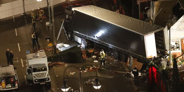 Authorites inspect a truck that had sped into a Christmas market in Berlin, on December 19, 2016, killing at least nine people and injuring dozens more.