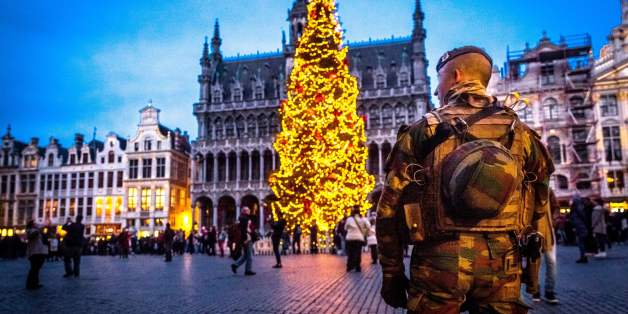 A serviceman patrols on the Grand-Place (Groote Markt) on the sidelines of the 'winter wonders' Christmas market, in Brussels on December 20,  2016. The 16th edition of the Christmas market with events is open from November 25 to January 1, 2017. Security was beefed up at Christmas markets across Europe after a lorry ploughed through a market in Berlin on December 19, 2016, killing 12 people and heightening security fears at the onset of the holiday season. The carnage in the German capital had