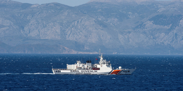 A Turkish coast guard ship patrols in the Aegean Sea, off the Turkish coast, April 20, 2016. The Bonn is part of a NATO naval presence in the Aegean Sea meant to observe and monitor illegal naval movement between Turkey and Greece.  REUTERS/John MacDougall/Pool