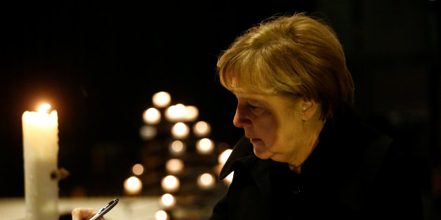 German Chancellor Angela Merkel signs the book of condolences on December 20, 2016 inside the Kaiser-Wilhelm-Gedaechtniskirche (Kaiser Wilhelm Memorial Church), the day after an attack at the nearby Christmas market in central Berlin. 