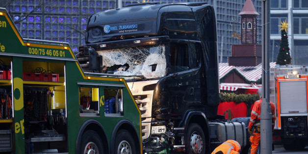 Rescue workers inspect the crashed truck at a Christmas market on Breitscheidplatz square near the fashionable Kurfuerstendamm avenue in the west of Berlin, Germany, December 20, 2016. REUTERS/Hannibal Hanschke