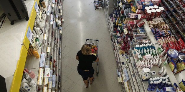 A customer pushes a shopping cart along a food aisle while shopping inside a local supermarket in Athens, Greece, on Friday, July 3, 2015. Shortages of commodities of broad consumption such as imported meat, beans, rice will start to be felt next week, EKathimerini says, citing unidentified people from the retail commerce sector. Photographer: Yorgos Karahalis/Bloomberg via Getty Images