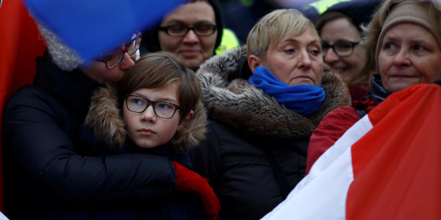 Demonstrators holding Polish and EU flags gather outside the Parliament building during a protest in Warsaw, Poland, December 17, 2016. REUTERS/Kacper Pempel