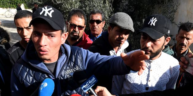 Walid (L) and Abdelkader(2nd R) Amri, the brothers of 24-year-old Anis Amri, the prime suspect in Berlin's deadly truck attack, talk to the media in front of their family house in the town of Oueslatia, in Tunisia's region of Kairouan on December 22, 2016. German authorities came under fire after it emerged that the prime suspect in Berlin's deadly truck attack, a rejected Tunisian asylum seeker, was known as a potentially dangerous jihadist.   / AFP / FETHI BELAID        (Photo credit should read FETHI BELAID/AFP/Getty Images)