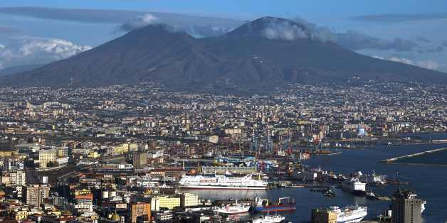 A picture taken from a terrace shows Naples' bay and the Vesuvius volcano on January 9, 2016 in Naples.  AFP PHOTO / GABRIEL BOUYS / AFP / GABRIEL BOUYS        (Photo credit should read GABRIEL BOUYS/AFP/Getty Images)
