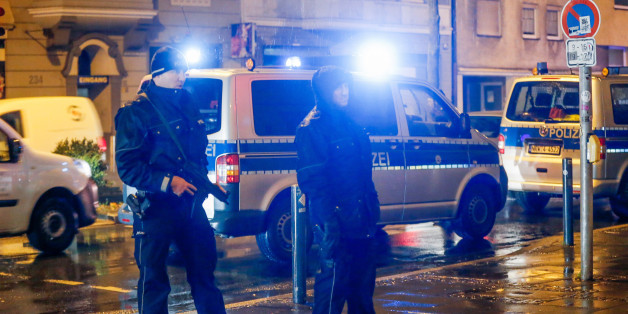 Policemen stand in front of a house in Dortmund, western Germany, on December 22, 2016. According to media reports, German police detained four people in the western city of Dortmund, probably in connection with the manhunt for 24-year-old Tunisian Anis Amri suspected of having committed the Berlin Christmas market terror attack on December 19, 2016. / AFP / DPA / Stephan SCHUETZE / Germany OUT        (Photo credit should read STEPHAN SCHUETZE/AFP/Getty Images)