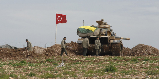 Turkish soldiers and an army tank take position at the new site of the Suleyman Shah tomb near the northern Syrian village of Esme, on the Syrian-Turkish border February 24, 2015. By extracting dozens of its soldiers surrounded by Islamist fighters in Syria, Turkey has warded off a potential crisis and shown its ability to manoeuvre between rival warring parties, including Islamic State. Several hundred Turkish ground troops, backed by tanks and drones, mounted an eight-hour operation on Saturday night to evacuate the 38 soldiers guarding the tomb of Suleyman Shah, grandfather of the founder of the Ottoman Empire. The fact there were no clashes appeared to suggest that Islamic State fighters surrounding the site were either warned or coerced by Turkey not to try to disrupt the incursion, the first it has mounted since Syria's civil war broke out in 2011. The Turkish Foreign Ministry said the tomb had been temporarily moved to a new site within Syria north of the village of Esme, close to the Turkish border.  REUTERS/Stringer (TURKEY - Tags: POLITICS MILITARY CONFLICT TPX IMAGES OF THE DAY)