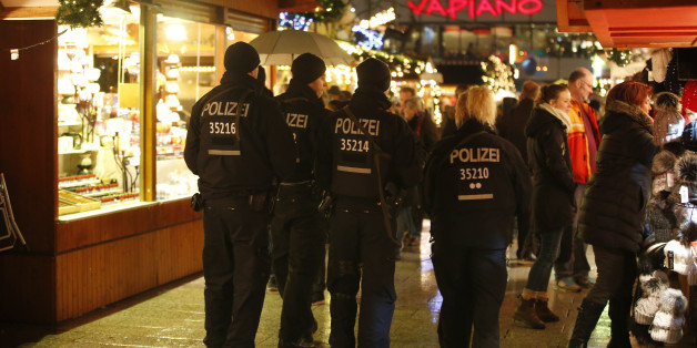 Police patrol at the re-opened Christmas market at Breitscheid square in Berlin, Germany, December 22, 2016, following an attack by a truck which ploughed through a crowd at the market on Monday night.      REUTERS/Fabrizio Bensch