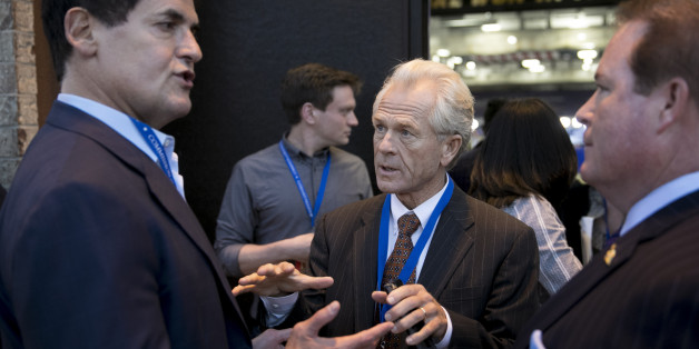 Peter Navarro, senior economic advisor to 2016 Republican Presidential Nominee Donald Trump, center, speaks with Mark Cuban, billionaire owner of the National Basketball Association's (NBA) Dallas Mavericks basketball team, left, outside the media filing center ahead of the first U.S. presidential debate at Hofstra University in Hempstead, New York, U.S., on Monday, Sept. 26, 2016. Trump and Hillary Clinton are locked in a tied two-way race for the presidency as they head into one of the most hi