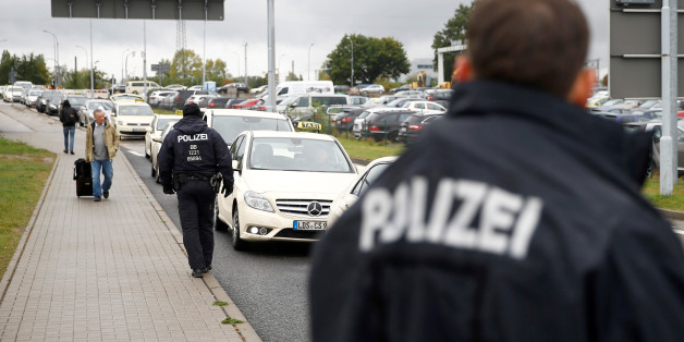 German policemen check cars on the entrance to Berlin-Schoenefeld airport, in Schoenefeld, near Berlin, October 9, 2016, following a suspicion that a bomb attack was being planned in Germany.  REUTERS/Axel Schmidt