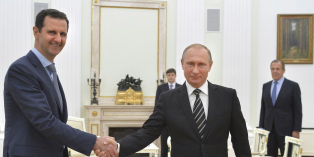 Russian President Vladimir Putin (R) shakes hands with Syrian President Bashar al-Assad during a meeting at the Kremlin in Moscow, Russia, October 20, 2015. Assad made a surprise visit to Moscow on Tuesday evening to thank Putin for launching air strikes against Islamist militants in Syria. Picture taken October 20, 2015. REUTERS/Alexei Druzhinin/RIA Novosti/Kremlin ATTENTION EDITORS - THIS IMAGE HAS BEEN SUPPLIED BY A THIRD PARTY. IT IS DISTRIBUTED, EXACTLY AS RECEIVED BY REUTERS, AS A SERVICE