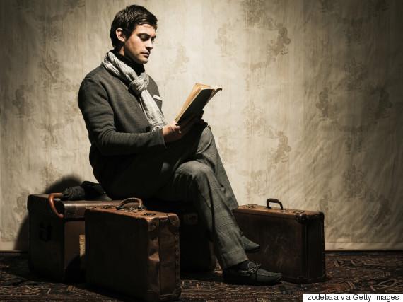 man reading sitting