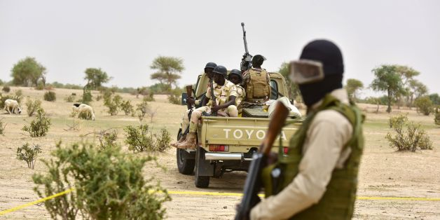 Niger Army armed forces patrol during a visit of Niger's Interior Minister to a camp for displaced populations near Diffa on June 16, 2016 following attacks by Boko Haram fighters in the region.Niger's Interior minister Mohamed Bazoum was paying a visit in Diffa today, after Boko Haram fighters on June 9 attacked a military post in Bosso in Niger's Diffa region, killing 26 soldiers including two from neighbouring Nigeria, in one of its deadliest attacks in Niger. / AFP / ISSOUF SANOGO        (Ph