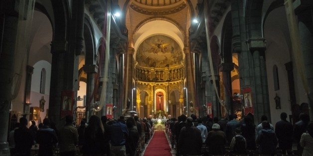 TUNIS, TUNISIA - DECEMBER 24: People attend a mass, led by Ilario Antoniazzi, Archbishop of Roman Catholic Archdiocese of Tunis during Christmas Eve, marking the birth of Jesus Christ, at St. Vincent de Paul Cathedral in Tunis, Tunisia on December 24, 2015. (Photo by Amine Landoulsi/Anadolu Agency/Getty Images)