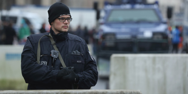 BERLIN, GERMANY - DECEMBER 23:  A heavily-armed policeman stands behind concrete security barriers near a police armoured vehicle near the Brandenburg Gate prior to a concert there on December 23, 2016 in Berlin, Germany. German authorities remain on high alert following the shooting of terror suspect Anis Amri by Italian police in Milan. Amri, who is thought to be the driver who drove a truck into a Berlin Christmas market on December 19, killing 12 people and injuring dozens, possibly had acco