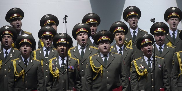 A picture taken on October 23, 2015 shows the official army choir of the Russian armed forces, also called Alexandrov Ensemble, performing at the Palais des Sports in Paris.  AFP PHOTO/JACQUES DEMARTHON        (Photo credit should read JACQUES DEMARTHON/AFP/Getty Images)
